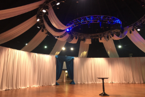 Event draping by white events in the mansion house with pipes and white curtains