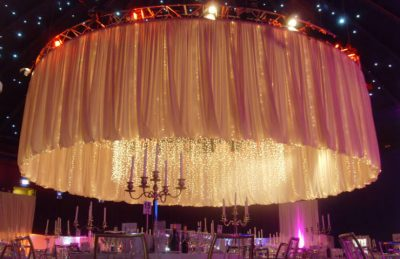 Oversized Fabric Chandelier with white drapery rental for a corporate management styling