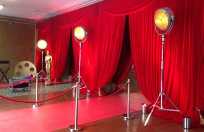 Hollywood red curtains entrance design with hollywood movie lights