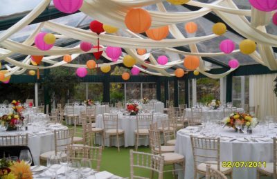 Wedding marquee interior with colourful paper lanterns
