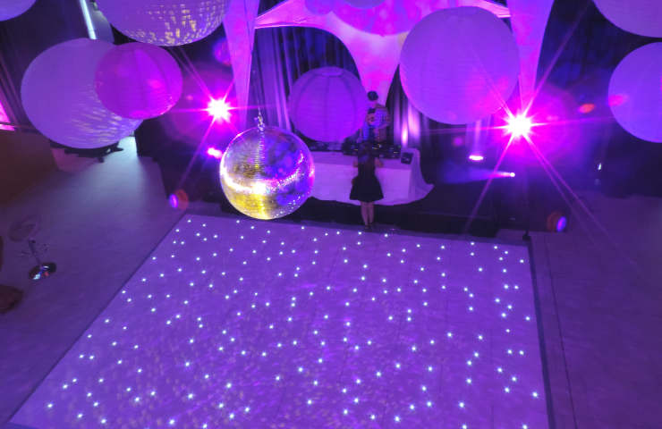 disco party with a white twinkle dance floor rental and disco ball
