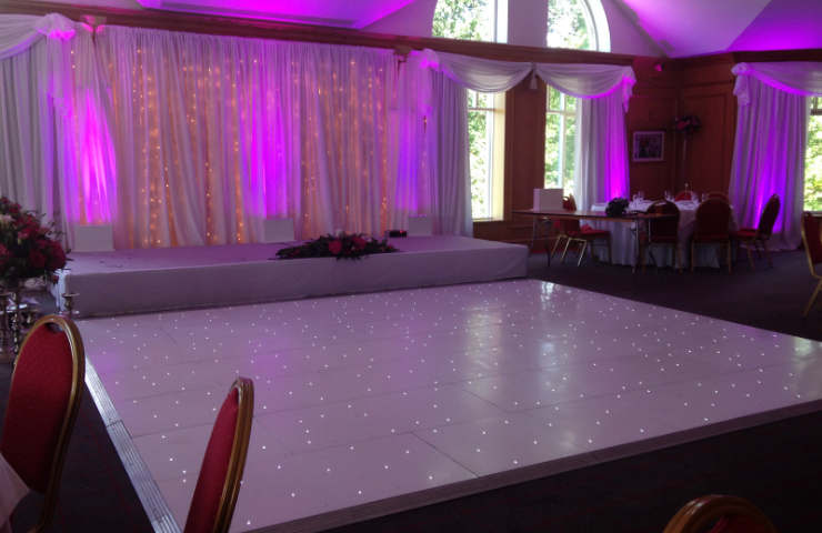 white dance floor and stage rental for events