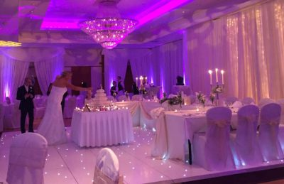 white dance floors for rental, wedding reception, cake cutting