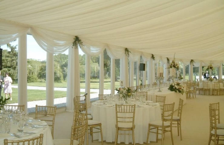 Marquee wedding interiors with white drapery and casement