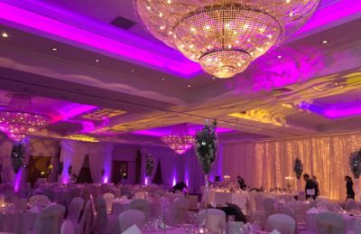 hotel wedding design with pipe and drape in white and ivory