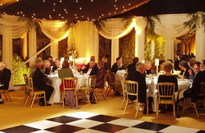 wedding marquees interiors in black and white design with chequered dance floor rental