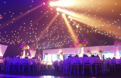 18th Birthday Party event decor with white chiavary chairs, black drape ceiling and fairy lights