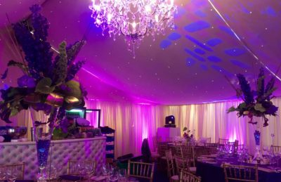 40th Birthday Party Decor with chandelier, high floral center pieces, soft ambient lightning, gold chiavary chairs and white drapery