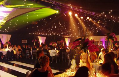 40th Private Party in a marquee design with black & white dance floor, silver chairs, orchid centre pieces and party lightning