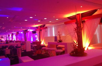 50th Birthday Party Decor in a modern, white sharp style, created with white drapery and high pod tables