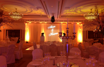 Elegant and soft wedding decor with golden candelabras, soft lightning and white theme