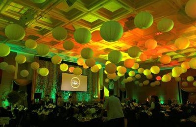 hanging lanterns on ceiling lit by green lights for rental