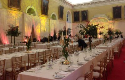 silver candelabras for hire and rental for events like corporate parties on top tables with gold chiavari chairs
