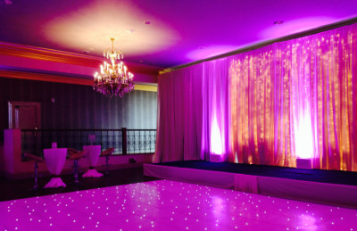 wedding hotel interiors with white dancefloor and pink light backdrop