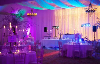 wedding drapery interiors with LED uplighters