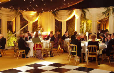 wedding marquees with a black and white dance floor rental