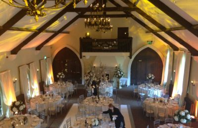 rustic hotel interior design with artificial flower centre pieces